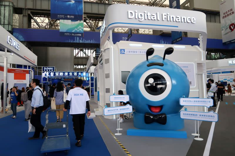 FILE PHOTO: Ant booth of digital finance products is seen at a fair during a fintech conference in Shanghai