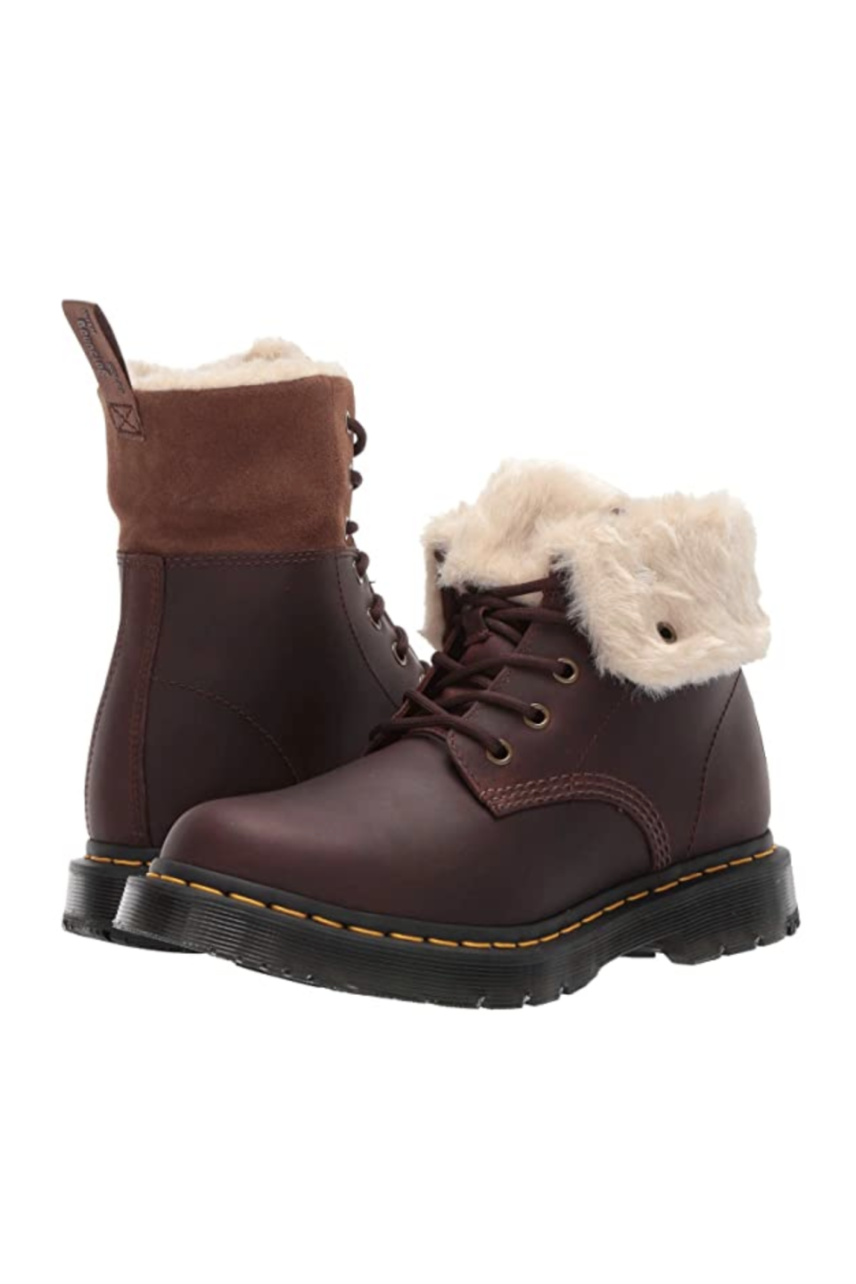 """<p><strong>Dr. Martens</strong></p><p>zappos.com</p><p><strong>$159.95</strong></p><p><a href=""""https://go.redirectingat.com?id=74968X1596630&url=https%3A%2F%2Fwww.zappos.com%2Fp%2Fdr-martens-1460-kolbert-wintergrip%2Fproduct%2F9057821&sref=https%3A%2F%2Fwww.marieclaire.com%2Ffashion%2Fg3388%2Fsnow-boots-for-women%2F"""" rel=""""nofollow noopener"""" target=""""_blank"""" data-ylk=""""slk:SHOP IT"""" class=""""link rapid-noclick-resp"""">SHOP IT</a></p><p>City dwellers might not need a heavy duty snow boot like those who live in the more suburban areas, so opt for these cozy leather Dr. Martens. They'll still protect you against the salted and icy streets, but look more fashion-forward thanks to the faux fur lining, which is revealed when you fold down the shaft. </p>"""