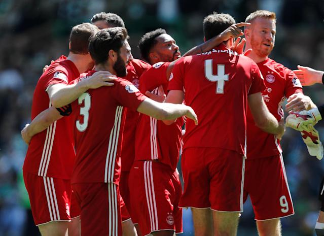 Soccer Football - Scottish Premiership - Celtic vs Aberdeen - Celtic Park, Glasgow, Britain - May 13, 2018 Aberdeen's Andrew Considine, Adam Rooney and team mates celebrate at the end of the match REUTERS/Russell Cheyne