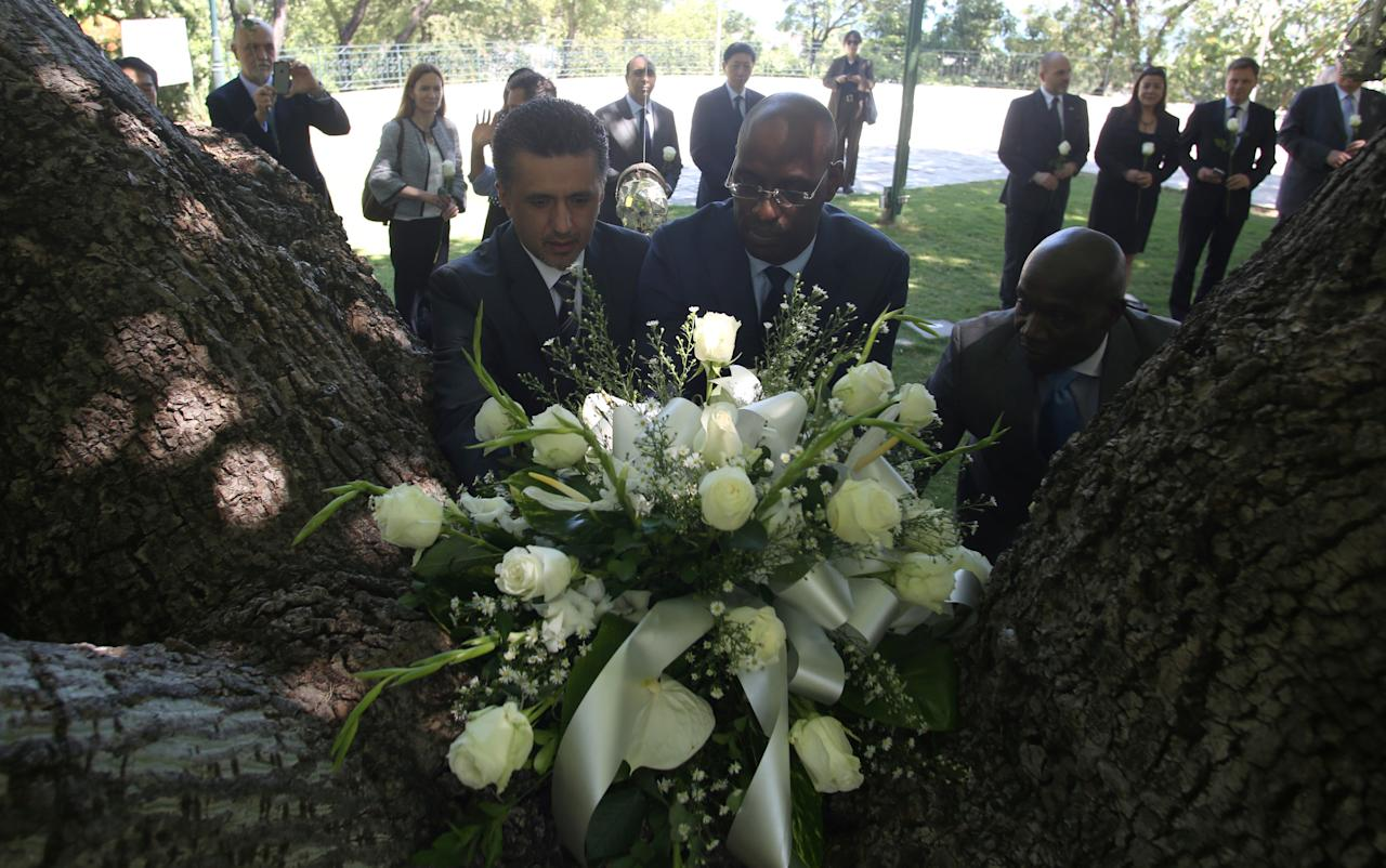 Permanent Representative of the Plurinational State of Bolivia to the United Nations Sacha Sergio Llorenti Soliz (L) and Haitian Minister of Planning and External Cooperation Alviol Fleurant place a wreath at a memorial for the victims of January 10, 2010, earthquake in a park of Port-au-Prince, Haiti, June 23, 2017. REUTERS/Jeanty Junior Augustin