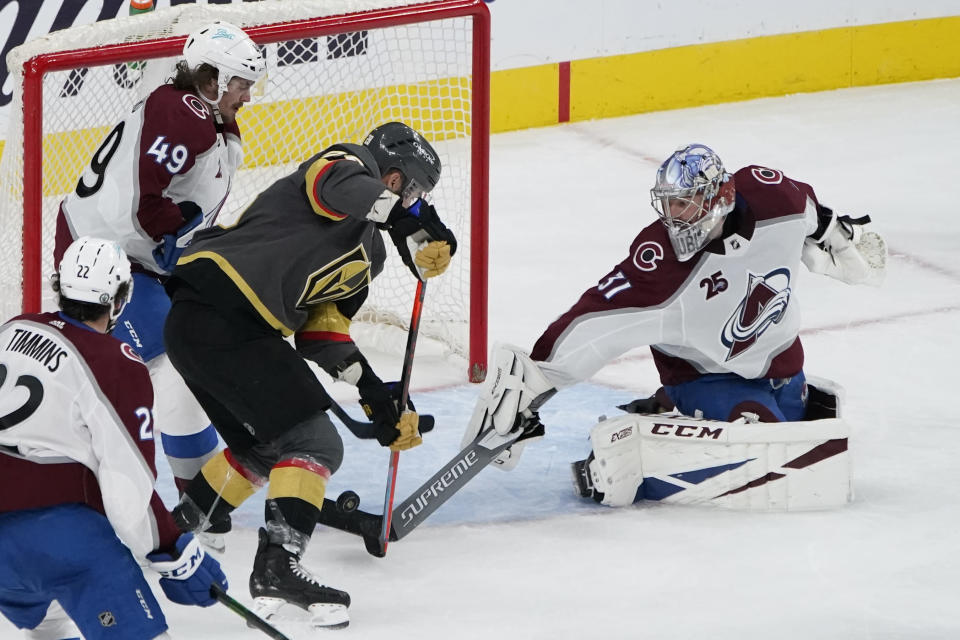 Vegas Golden Knights left wing William Carrier (28) scores a goal against Colorado Avalanche goaltender Philipp Grubauer (31) during the third period in Game 6 of an NHL hockey Stanley Cup second-round playoff series Thursday, June 10, 2021, in Las Vegas. (AP Photo/John Locher)