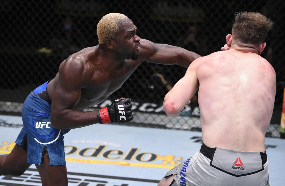 LAS VEGAS, NEVADA - AUGUST 01: (L-R) Derek Brunson punches Edmen Shahbazyan in their middleweight fight during the UFC Fight Night event at UFC APEX on August 01, 2020 in Las Vegas, Nevada. (Photo by Chris Unger/Zuffa LLC via Getty Images)