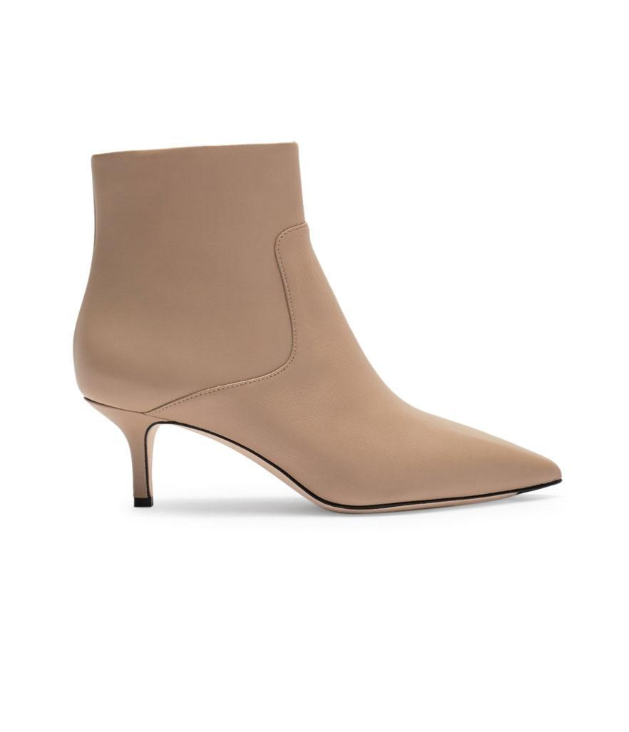 """<p>Made of smooth leather, these boots feature a short kitten heel and sleek pointed toe.<br><a href=""""https://fave.co/2OsWcoj"""" rel=""""nofollow noopener"""" target=""""_blank"""" data-ylk=""""slk:Shop it:"""" class=""""link rapid-noclick-resp"""">Shop it:</a> Maggie Pointed Toe Bootie, $120, <a href=""""https://fave.co/2OsWcoj"""" rel=""""nofollow noopener"""" target=""""_blank"""" data-ylk=""""slk:nordstromrack.com"""" class=""""link rapid-noclick-resp"""">nordstromrack.com</a> </p>"""