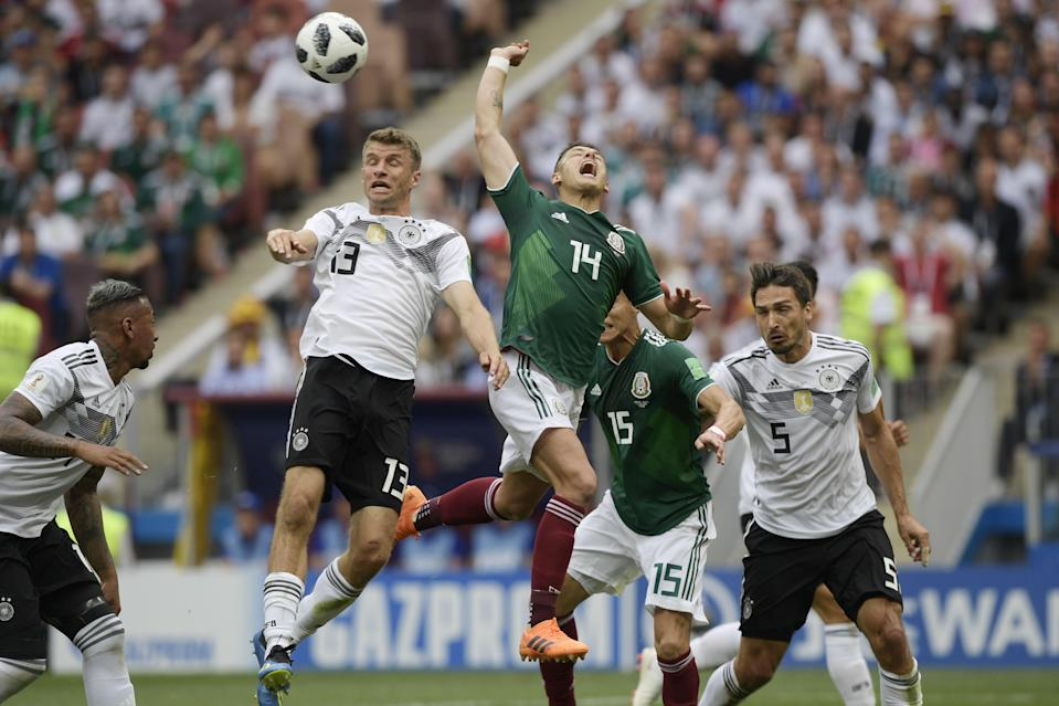 <p>Germany's forward Thomas Mueller (2L) and Mexico's forward Javier Hernandez (4R) jump for the ball during the Russia 2018 World Cup Group F football match between Germany and Mexico at the Luzhniki Stadium in Moscow on June 17, 2018. (Photo by Juan Mabromata / AFP) </p>