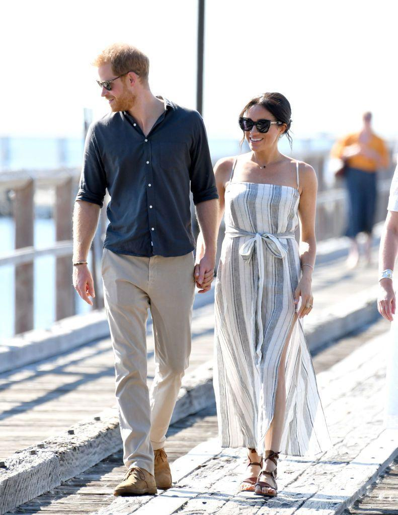 """<p>Harry and Meghan visited Fraser Island, Australia o<a href=""""https://www.townandcountrymag.com/style/fashion-trends/a24061797/meghan-markle-reformation-striped-dress-royal-tour-australia/"""" rel=""""nofollow noopener"""" target=""""_blank"""" data-ylk=""""slk:n day seven of their royal tour"""" class=""""link rapid-noclick-resp"""">n day seven of their royal tour</a>. For the beach-side outing, the Duchess wore a casual dress by Reformation with brown sandals by Sarah Flint, one of her favorite designers. </p><p><a class=""""link rapid-noclick-resp"""" href=""""https://go.redirectingat.com?id=74968X1596630&url=https%3A%2F%2Fwww.sarahflint.com%2Fproducts%2Fgrear-saddle-vachetta%3FclickId%3D2474057999%26publisherId%3D73861%26variant%3D36798923201&sref=https%3A%2F%2Fwww.townandcountrymag.com%2Fstyle%2Ffashion-trends%2Fg3272%2Fmeghan-markle-preppy-style%2F"""" rel=""""nofollow noopener"""" target=""""_blank"""" data-ylk=""""slk:SHOP NOW"""">SHOP NOW</a> <em>Sarah Flint Grear Sandals, $245</em></p>"""