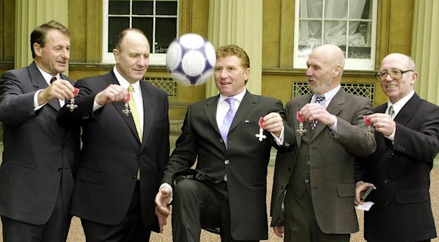 Honours all round: Wilson and his fellow 1966 stars are awarded an MBE by the Queen