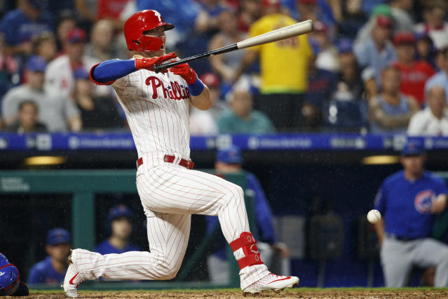 Philadelphia Phillies' Corey Dickerson reacts after being hit by a pitch from Chicago Cubs starting pitcher Jose Quintana during the third inning of a baseball game, Tuesday, Aug. 13, 2019, in Philadelphia. (AP Photo/Matt Slocum)