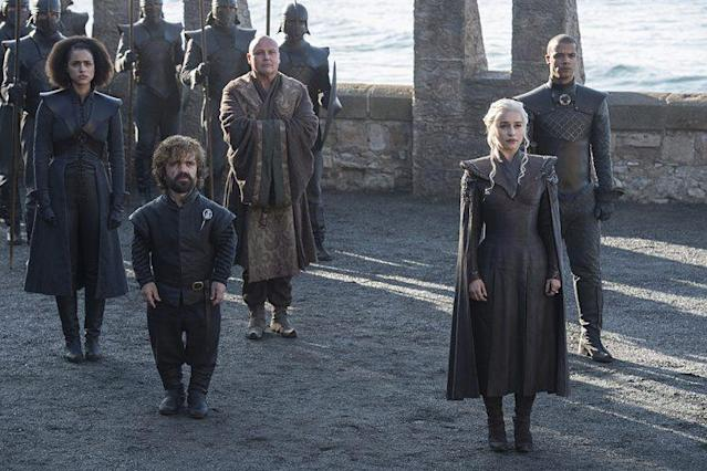 Nathalie Emmanuel as Missandei, Peter Dinklage as Tyrion Lannister, Conleth Hill as Lord Varys, Emilia Clarke as Daenerys Targaryen, and Jacob Anderson as Grey Worm in HBO's 'Game of Thrones' (Photo Credit: HBO)