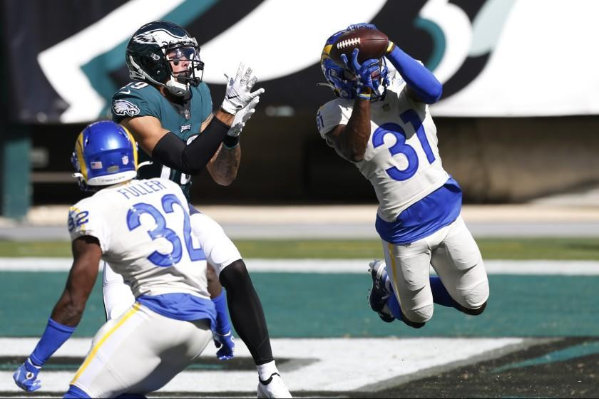 Los Angeles Rams' Darious Williams (31) intercepts a pass intended for Philadelphia Eagles' J.J. Arcega-Whiteside (19) during the second half of an NFL football game, Sunday, Sept. 20, 2020, in Philadelphia. (AP Photo/Laurence Kesterson)