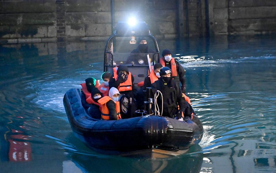Migrants are brought to Dover by Border Force officers after being intercepted in the Channel and handed over by French authorities - STEVE FINN PHOTOGRAPHY