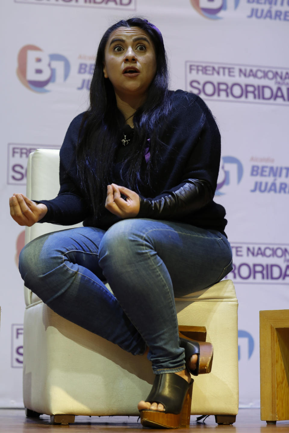 """Olimpia Coral Melo, who became an activist against online sexual harassment and assault after a video of her having sex was published online in 2013, speaks during a live broadcast with Benito Juarez borough Mayor Santiago Taboada, in Mexico City, Monday, Nov. 23, 2020. Melo's story and subsequent activism have led to the creation of numerous state laws against cyber violence, and Mexico's government is on the verge of passing a federal version of """"Olimpia's Law."""" (AP Photo/Rebecca Blackwell)"""