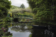 The Japanese-inspired water garden of Claude Monet's house, French impressionist painter who lived from 1883 to 1926, waits ahead of the re-opening, in Giverny, west of Paris, Monday May 17, 2021. Lucky visitors who'll be allowed back into Claude Monet's house and gardens for the first time in over six months from Wednesday will be treated to a riot of color, with tulips, peonies, forget-me-nots and an array of other flowers all competing for attention. (AP Photo/Francois Mori)
