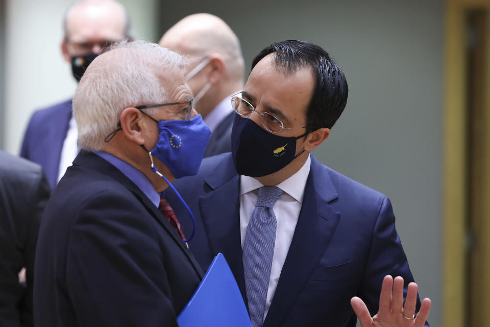 European Union foreign policy chief Josep Borrell, left, talks to Cypriot Foreign Minister Nikos Christodoulides during a European Foreign Affairs Ministers meeting at the European Council headquarters in Brussels, Monday, March 22, 2021. (Aris Oikonomou, Pool Photo via AP)