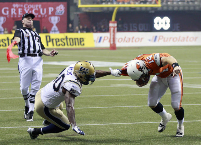 VANCOUVER, CANADA - NOVEMBER 27: Odell Willis #40 of the Winnipeg Blue Bombers draws a flag for this tackle on Travis Lulay #14 of the BC Lions during the CFL 99th Grey Cup November 27, 2011 at BC Place in Vancouver, British Columbia, Canada. (Photo by Jeff Vinnick/Getty Images)
