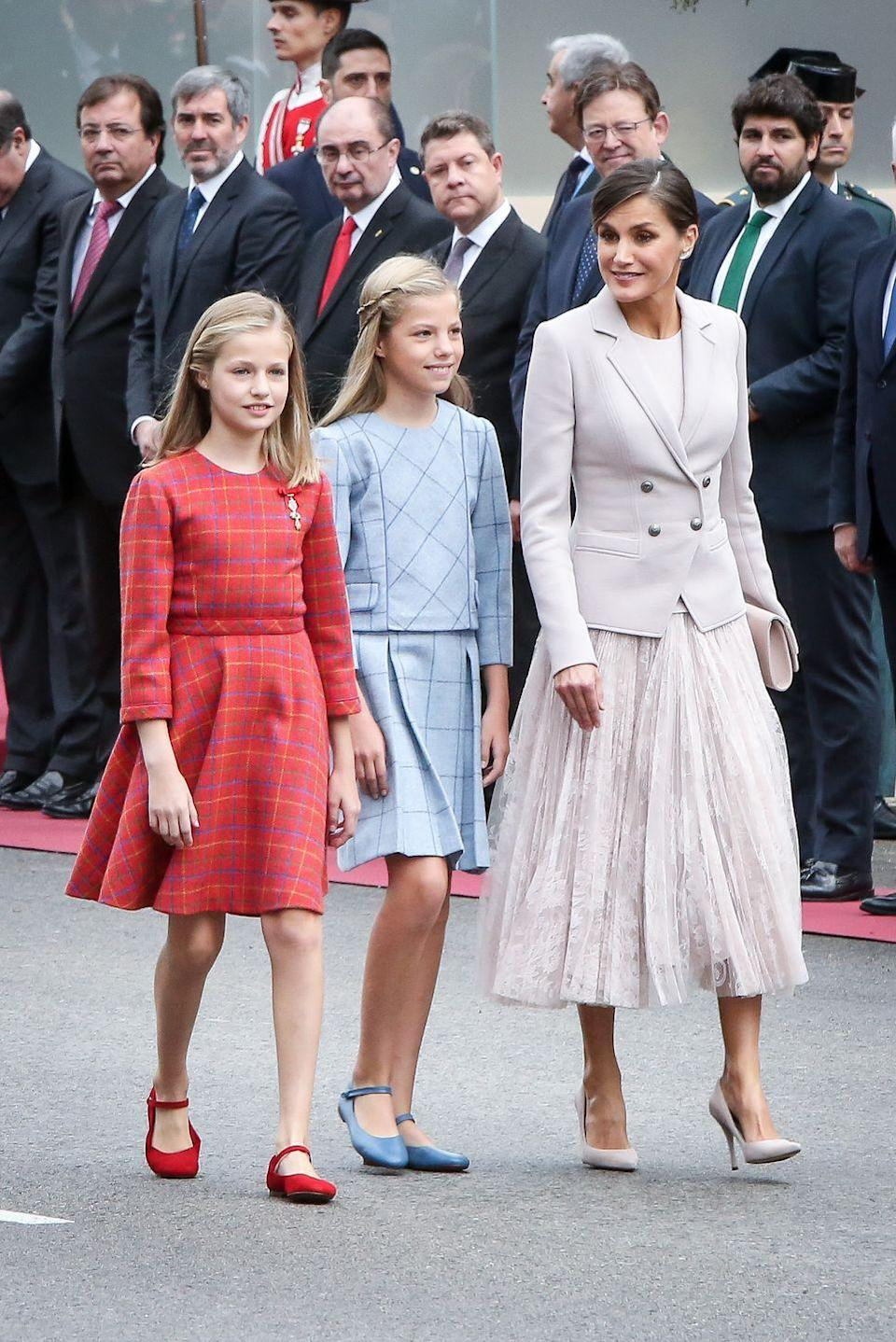 <p>Accompanied by her two daughters, Letizia sported a daytime look, with a matching blazer and tea-length skirt. </p>