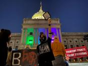 Activists rally at the Pennsylvania State Capitol Building to protest attempts to halt the counting of ballots cast in the state for the 2020 presidential election
