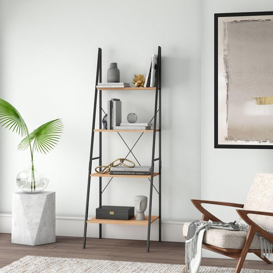 """<h2>Mercury Row Metal Ladder Bookcase</h2><br><strong>Deal: 5% off</strong><br>Although this bookcase is not necessarily on super sale, it was still one of our bestselling products this entire past year and hey, it's still under $100. <br><br><em>Shop</em> <strong><em><a href=""""https://www.wayfair.com/brand/bnd/mercury-row-b33808.html"""" rel=""""nofollow noopener"""" target=""""_blank"""" data-ylk=""""slk:Mercury Row"""" class=""""link rapid-noclick-resp"""">Mercury Row</a></em></strong><br><br><strong>Mercury Row</strong> Metal Ladder Bookcase, $, available at <a href=""""https://go.skimresources.com/?id=30283X879131&url=https%3A%2F%2Fwww.wayfair.com%2Ffurniture%2Fpdp%2Fmercury-row-almanzar-7087-h-x-2362-w-metal-ladder-bookcase-mcrw7414.html"""" rel=""""nofollow noopener"""" target=""""_blank"""" data-ylk=""""slk:Wayfair"""" class=""""link rapid-noclick-resp"""">Wayfair</a>"""