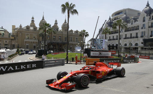 German driver Sebastian Vettel steers his Ferrari during the third free practice at the Monaco racetrack, in Monaco, Saturday, May 26, 2018. The Formula one race will be held on Sunday. (AP Photo/Luca Bruno)