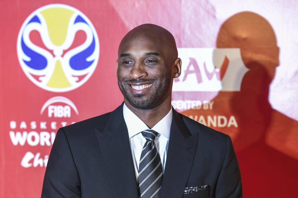 Former basketball player Kobe Bryant reacts prior to the draw ceremony of 2019 FIBA Basketball World Cup in Shenzhen, in southern China's Guangdong Province, Saturday, March 16, 2019. The United States' quest for a third straight FIBA World Cup championship will begin with matchups against Turkey, the Czech Republic and Japan this summer. (Mao Siqian/Xinhua via AP)