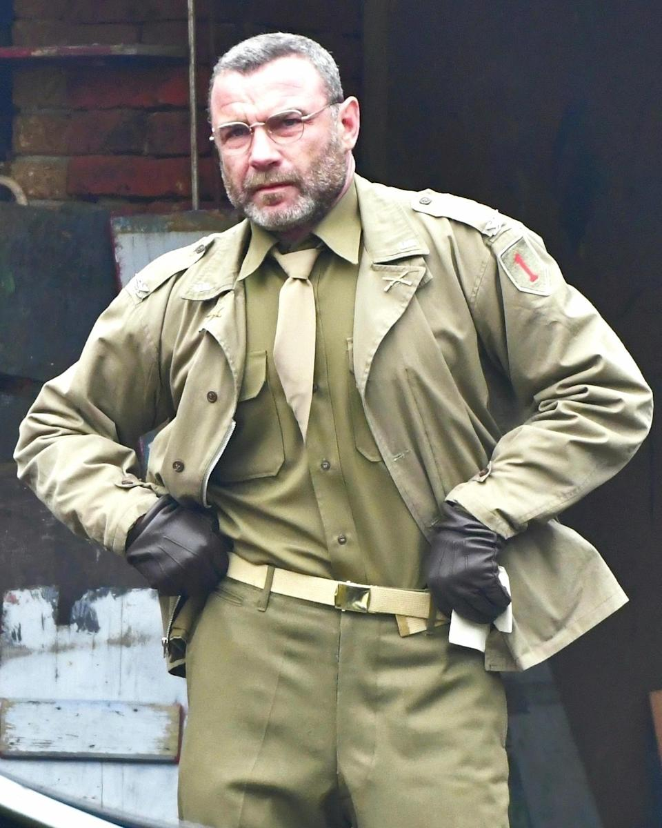 <p>Liev Schreiber takes pause on Friday on the Venice, Italy, set of <em>Across the River and Into the Trees</em>.</p>