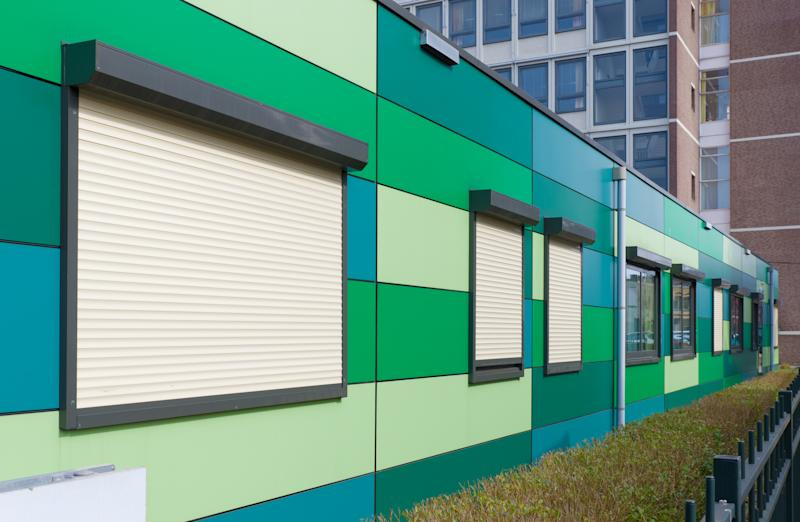 Modular building in shades of green.