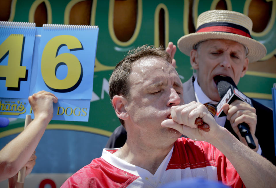 Joey Chestnut eats two hot dogs at a time during the Nathan's Hot Dog Eating Contest on July 4, 2017, in New York.