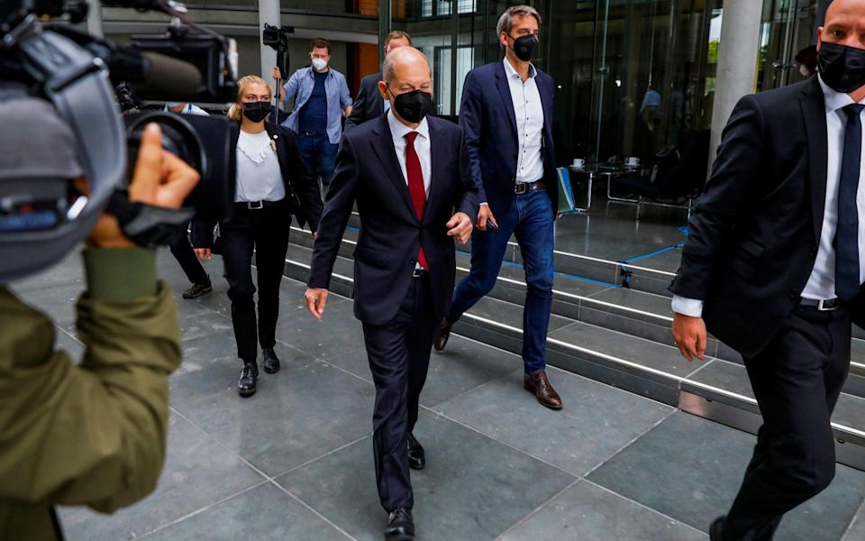 German Finance Minister and SPD candidate for the Chancellery Olaf Scholz leaves a Finance commission of inquiry at the German Parliament or Bundestag in Berlin, Germany, September 20, 2021. REUTERS/Michele Tantussi - MICHELE TANTUSSI/REUTERS