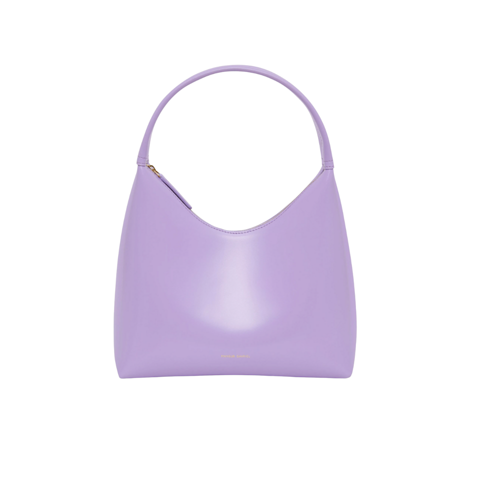 """Indulge her sweet tooth with Mansur Gavriel's new Candy bag, dreamed up in the prettiest lilac hue and on-trend <a href=""""https://www.glamour.com/story/how-to-dress-90s?mbid=synd_yahoo_rss"""" rel=""""nofollow noopener"""" target=""""_blank"""" data-ylk=""""slk:'90s shape"""" class=""""link rapid-noclick-resp"""">'90s shape</a>. $495, Mansur Gavriel. <a href=""""https://www.mansurgavriel.com/products/candy-bag-lavender"""" rel=""""nofollow noopener"""" target=""""_blank"""" data-ylk=""""slk:Get it now!"""" class=""""link rapid-noclick-resp"""">Get it now!</a>"""