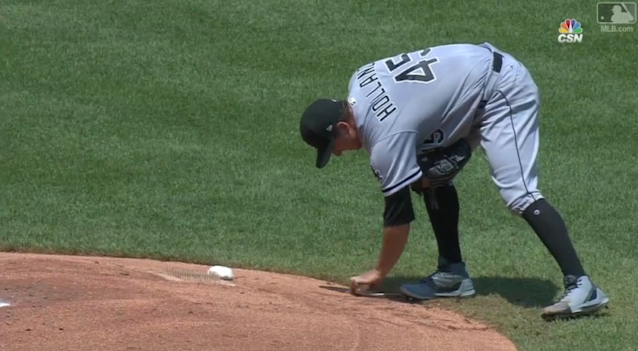 "Derek Holland writes ""Granny"" and ""Sister Frances"" on the back of the mound at Kauffman Stadium. (MLB.com)"