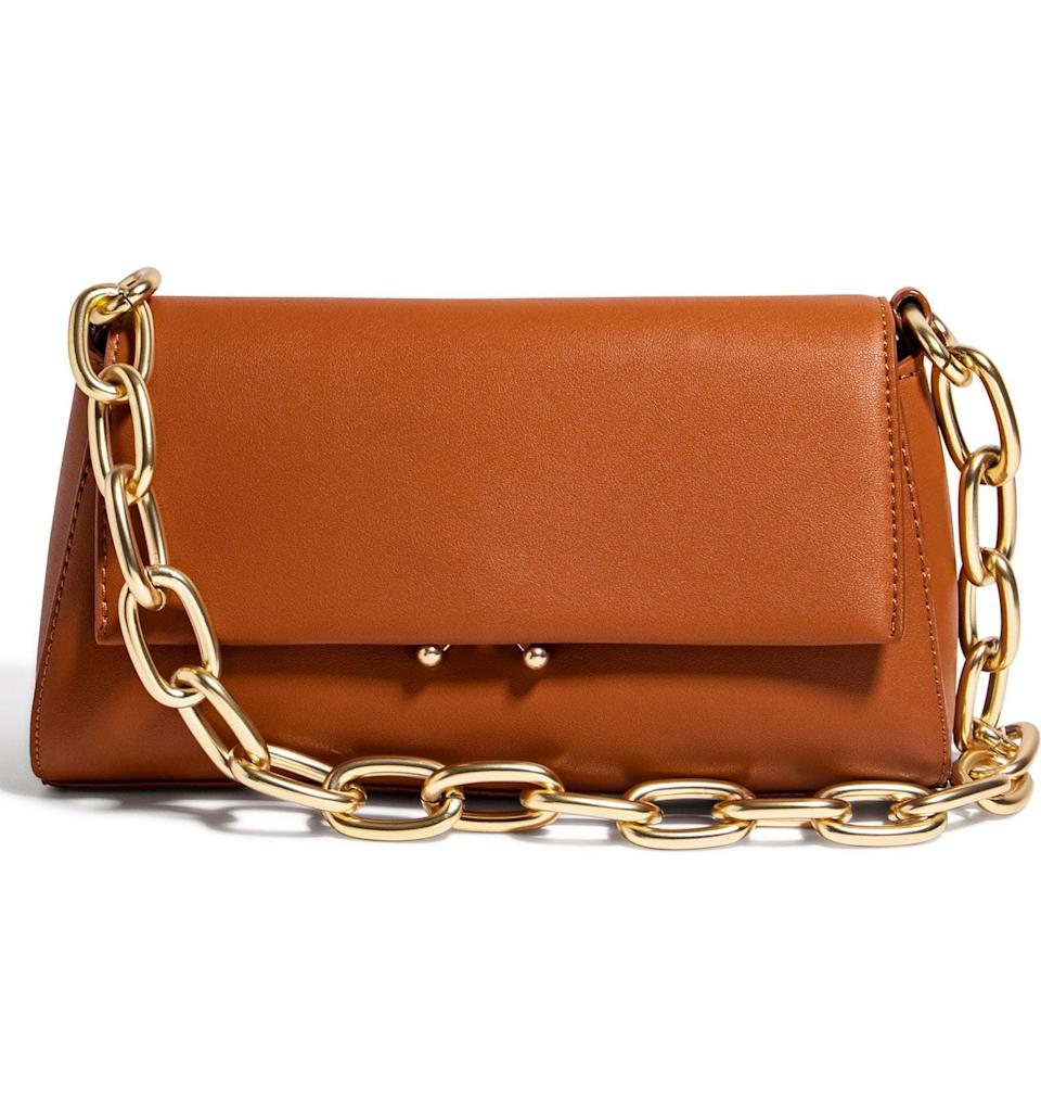 <p>The shape of this stylish <span>House of Want We Fashion Vegan Leather Shoulder Bag</span> ($98) is retro-inspired, but the vegan leather makes it cool and modern. It's a chic shoulder bag you'll want to take everywhere with you.</p>