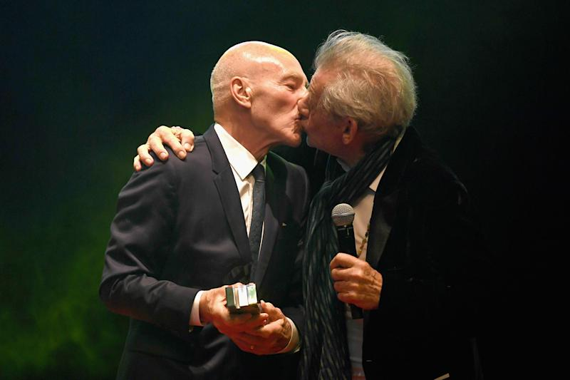 Pucker up: Sir Ian McKellen kisses Sir Patrick Stewart: Ian Gavan/Getty