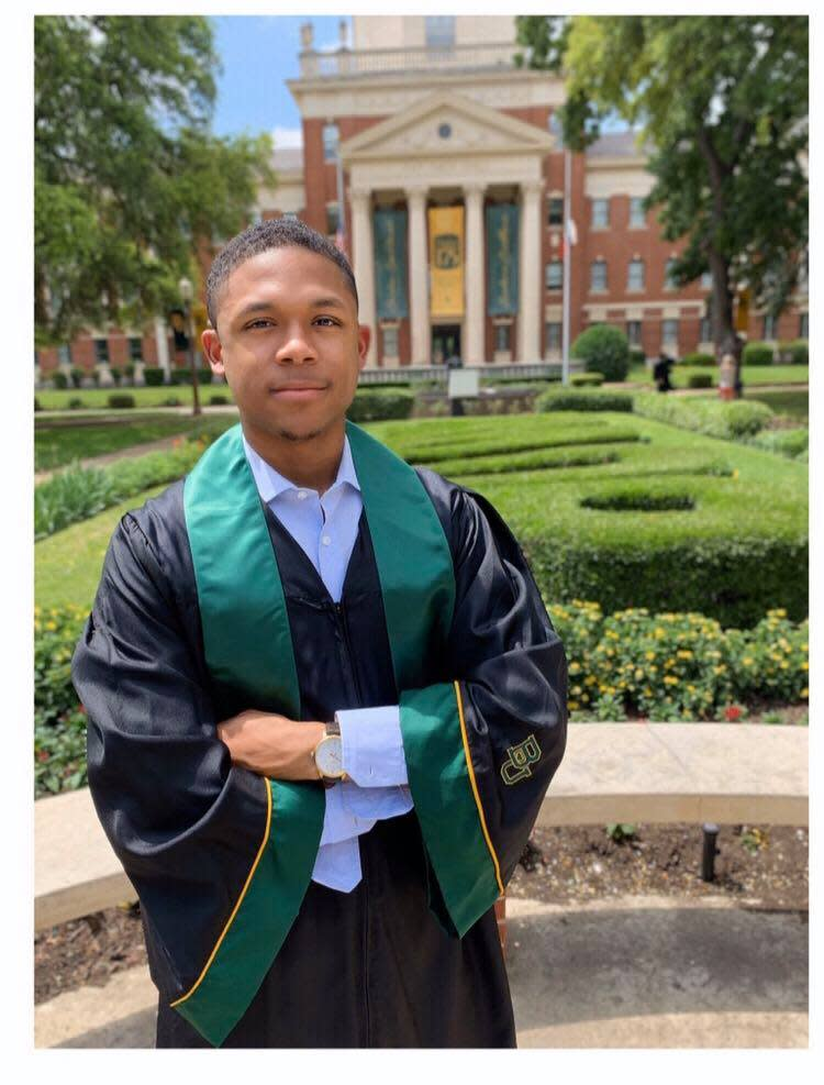 Williams poses in his cap and gown in front of Baylor University. (Photo: Courtesy of Ayanna Tatum)