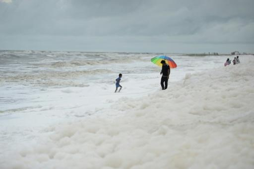 Word of the risks have not got through to the hundreds of families who throng India's longest urban beach, letting children happily skip in the toxin-filled froth