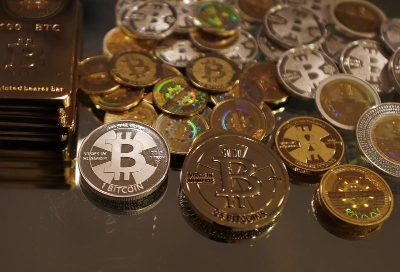 Bitcoins created by Mike Caldwell are seen in this photo illustration at his office in Sandy, Utah