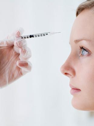 woman getting botox on face