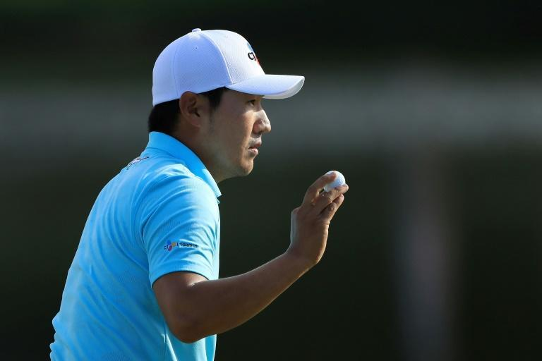 South Korea's Kang Sung acknowledges fans on the way to a share of the halfway lead in the US PGA Tour's Arnold Palmer Invitational (AFP Photo/SAM GREENWOOD)