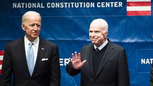 PHOTO: Sen. John McCain, right, accompanied by Chair of the National Constitution Center's Board of Trustees, former Vice President Joe Biden, waves as he takes the stage before receiving the Liberty Medal in Philadelphia, Oct. 16, 2017. (Matt Rourke/AP)