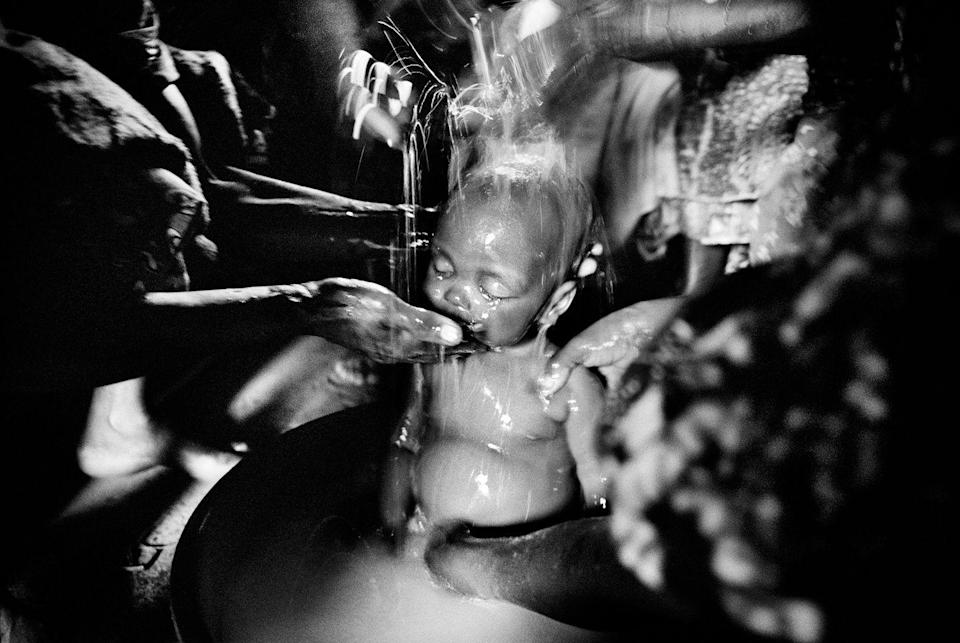 <p>2004. The body of eight-month-old Sakura Lisi is bathed for burial in Mongbwalu, northeaster Congo.</p>