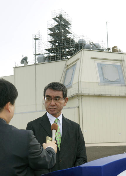 Japanese Defense Minister Taro Kono speaks to reporters on the Hawaiian island of Kauai after inspecting an Aegis Ashore missile-defense system at the Pacific Missile Range Facility of the U.S. Navy on Jan. 13, 2020. Kono told reporters in Tokyo Monday, June 15, 2020 that his ministry has decided to suspend unpopular plans to deploy a costly land-based U.S. missile combat systems aimed at bolstering the country's defense against escalating threats from North Korea. The decision to virtually scrap the plan to buy two Aegis Ashore systems came after the plan had already faced a series of setbacks including land survey data, repeated cost estimate hikes and safety concerns that led to persistent local opposition. (Kyodo News via AP)