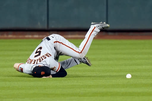 San Francisco Giants right fielder Mike Yastrzemski tumbles while trying to catch a two-run double by Houston Astros' Josh Reddick during the second inning of a baseball game Tuesday, Aug. 11, 2020, in Houston. (AP Photo/David J. Phillip)