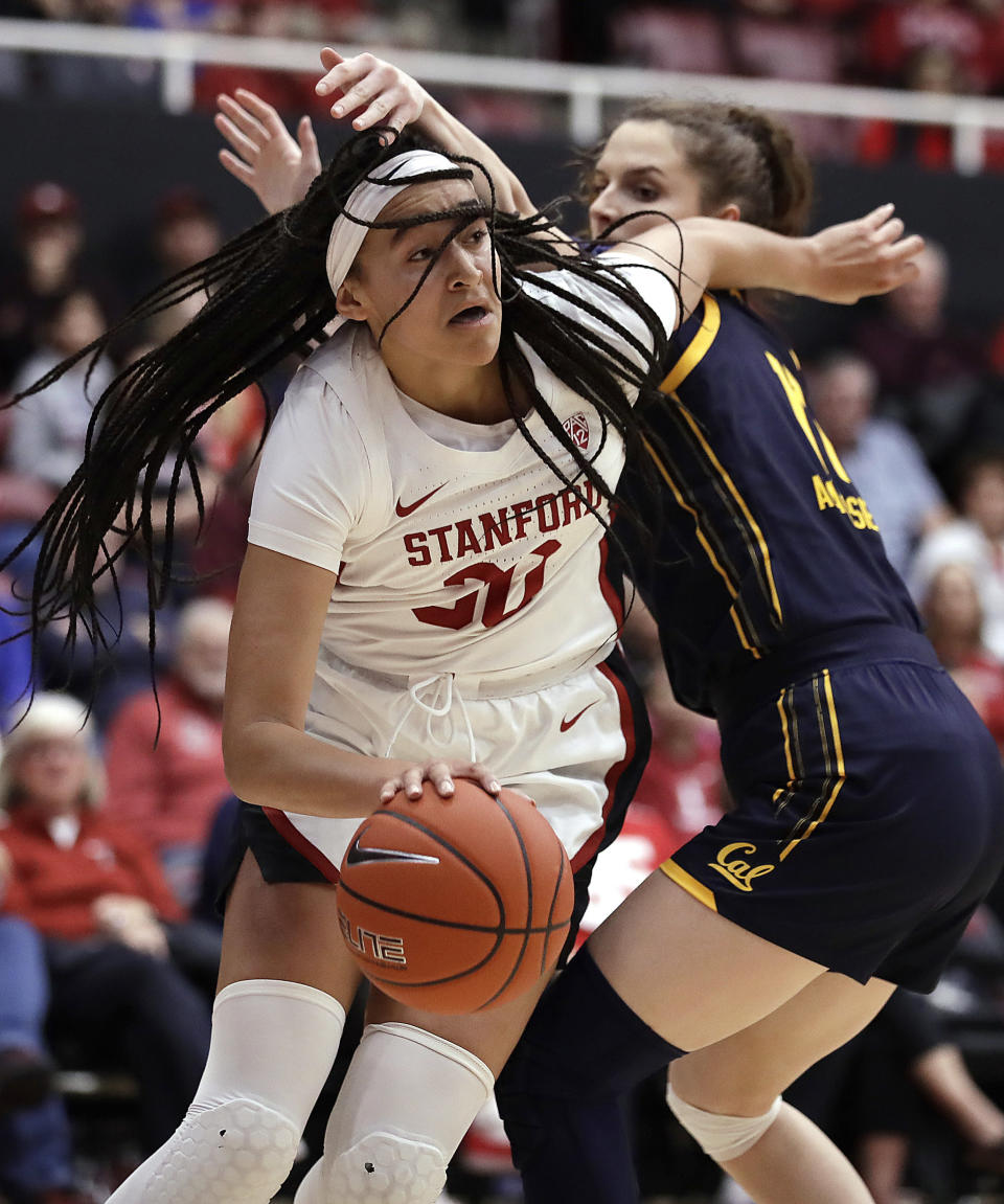 Stanford guard Haley Jones, left, drives the ball past California's Sara Anastasieska during the first half of an NCAA college basketball game Friday, Jan. 10, 2020, in Stanford, Calif. (AP Photo/Ben Margot)
