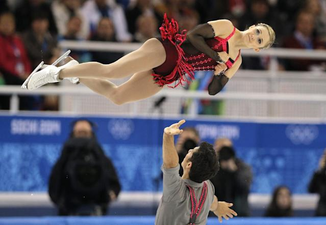 Paige Lawrence and Rudi Swiegers of Canada compete in the pairs short program figure skating competition at the Iceberg Skating Palace during the 2014 Winter Olympics, Tuesday, Feb. 11, 2014, in Sochi, Russia. (AP Photo/Vadim Ghirda)