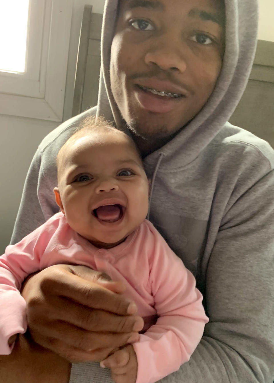 Image: Raheem Nixon, 19, and his 8 month old daughter Alayah. He has been banished to virtual instruction at his high school near Reading, Pa. (Family Handout)