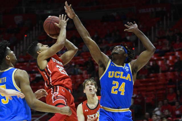 Utah guard Alfonso Plummer (25) shoots over UCLA forward Jalen Hill (24) during the second half of an NCAA college basketball game Thursday, Feb. 20, 2020, in Salt Lake City. (AP Photo/Alex Goodlett)