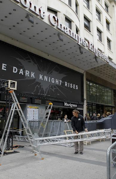 """Workers dismantle an installation setup for the premiere of """"The Dark Knight Rises"""", scheduled to be held Friday night in Paris, Friday, July 20, 2012, which has been canceled after a gunman killed 12 people at a Colorado opening of the same film, The night before in a Denver suburb, a man wearing a gas mask released an unknown gas into a crowded movie theater and opened fire. Twelve people were killed and at least 50 wounded. (AP Photo/Jacques Brinon)"""