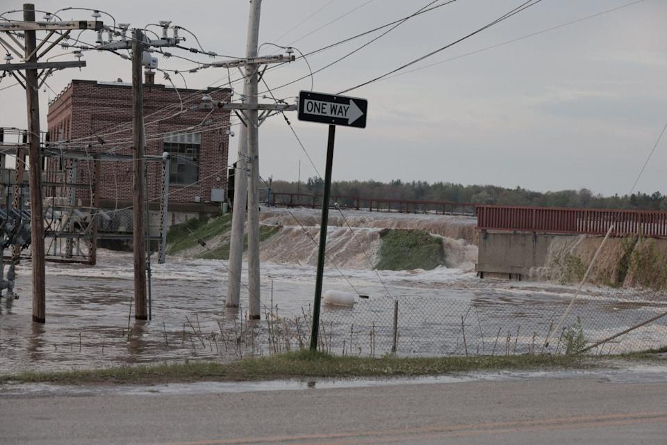 Floodwaters overflow at Sanford Dam, Michigan, in this May 19, 2020, picture obtained from social media.