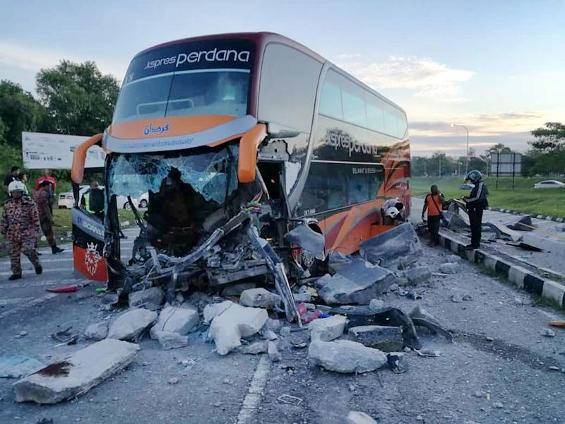 Bus driver Mohamad Azizul Che Aziz, 31, and Universiti Teknologi Mara Seri Iskandar student Munzirah Jalaludin were killed in the accident. — Picture by Marcus Pheong