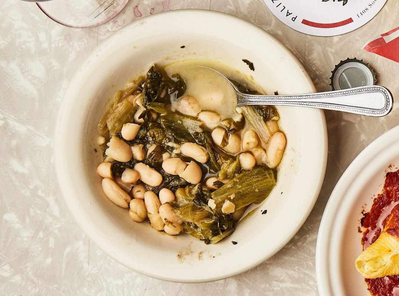 "This makes an extra quart of cooked beans. Save (or freeze) for another batch of escarole, or serve them simply warmed in their broth. This recipe is from <a href=""http://www.bonappetit.com/story/palizzi/?mbid=synd_yahoo_rss"">Palizzi Social Club</a> in Philadelphia, our <a href=""http://www.bonappetit.com/hot10?mbid=synd_yahoo_rss"">#4 Best New Restaurant in America 2017</a>. <a href=""https://www.bonappetit.com/recipe/escarole-with-cannellini-beans?mbid=synd_yahoo_rss"">See recipe.</a>"