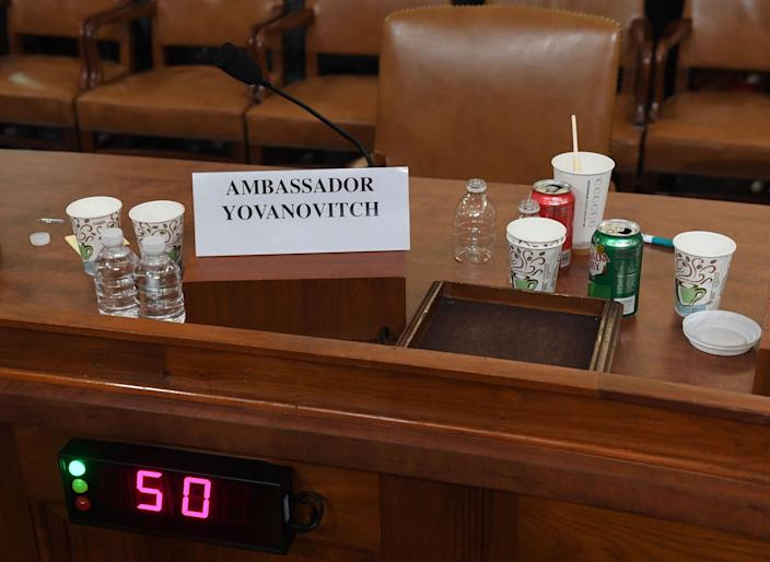 Drinks are seen at the bench for Former US Ambassador to the Ukraine Marie Yovanovitch during testimony before the House Permanent Select Committee on Intelligence as part of the impeachment inquiry into US President Donald Trump, on Capitol Hill on November 15, 2019 in Washington DC.