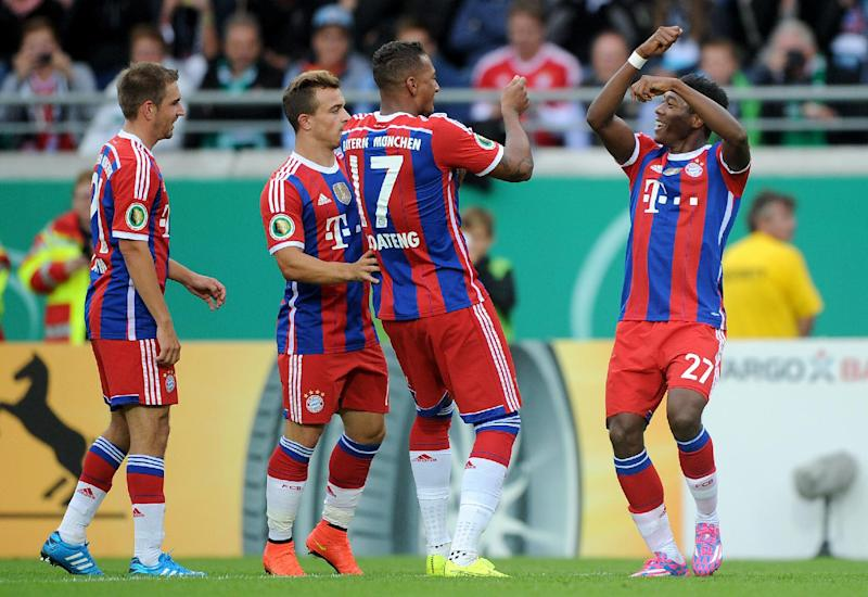 (L-R) Bayern Munich's Philipp Lahm, Xherdan Shaqiri, Jerome Boateng and David Alaba celebrate after Alaba scores during the German cup match against SC Preussen Muenster in western Germany on August 17, 2014